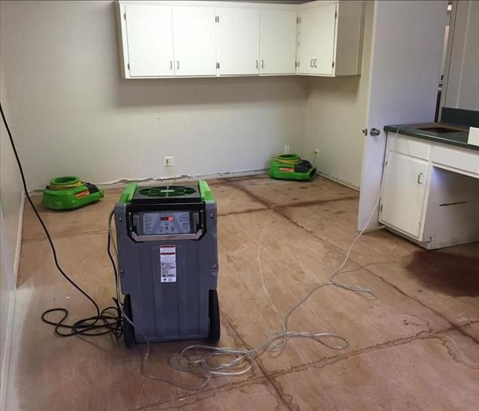 Equipment placed to dry out wet flooring.