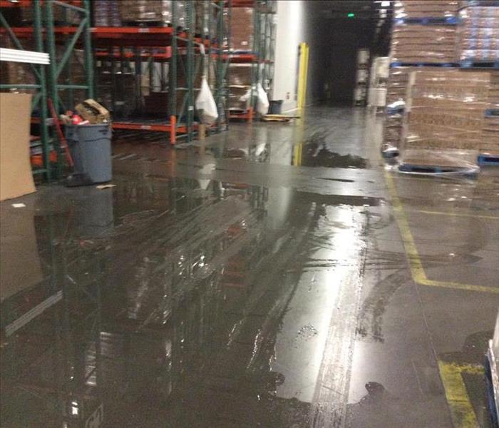 Warehouse suffered flooding and water damage.